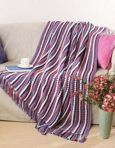 All-American Denim Stripes    Design by Melissa Leapman    This cozy afghan is like a warm hug from a special friend.    Skill Level  Beginner    Finished Size  50 x 70 inches, not including Fringe