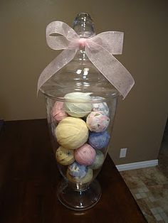apothecary jar filled with fabric covered styrofoam balls