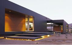 Another stunning prefab.  Love the lighting underneath the slabs.