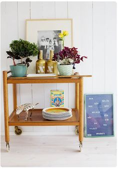 Add casters to a table for a sweet bar cart.