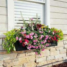 We love this gorgeous window box! Find out what flowers were used to create this look: http://www.bhg.com/gardening/container/plans-ideas/plant-combinations-for-sunny-spot-window-boxes/?socsrc=bhgpin032013windoxbox