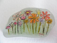 Wildflower garden  miniature painting on sea glass by Alienstoatdesigns