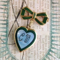 Adore this vintage locket pin in emerald and blue. #vintage_brooch