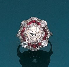 A belle époque diamond and ruby cluster ring, circa 1910.