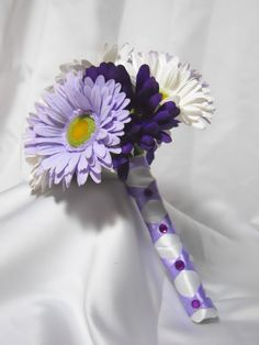 I would just do the dark purple and white daisies with a matching dark purple ribbon.