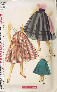 Vintage 50's Circle Skirt Pattern    Choice of fabric and the imaginative use of trimmings gives an individual look to each version of this flared Skirt pattern styled with to gores.  In View 1 rick rack accents each seam.  View 2, the more tailored version, is shown with pointed tab and button trim at front waistline.  Two rows of Novelty braid detail view 3.