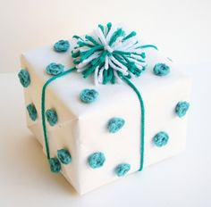 Crochet polka dot details are one of the cutest DIY wrapping ideas we've seen!