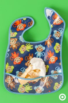 That first ice cream cone may not land in your baby's mouth. Be prepared with the Easywipe bib from Neat Solutions. The built-in pocket catches drips, spills and falling objects. And, the beauty of this bib is that it wipes clean.