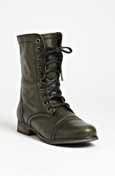 Dark green military boots for fashionable fall footwear.