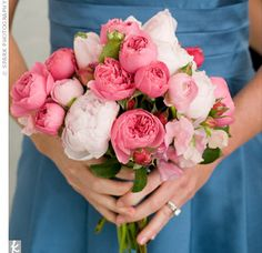 A pink and white bouquet made of peonies and garden roses.