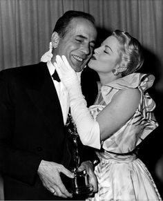 Humphrey Bogart gets a smooch, 1951. #kiss #kisses #kissing #couple #love #passion #romance