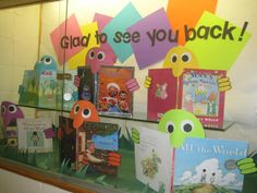Used book jackets and face  hands to create readers for a back to school display.