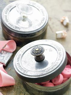 add drawer pulls to plain tins to make decorative gift boxes