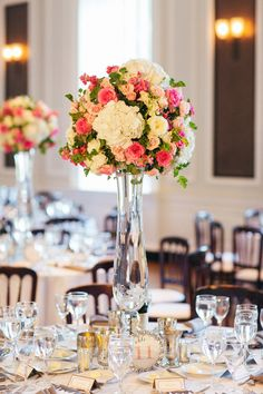 Wedding Centerpiece - Tall Glass Vase with Classic Pink & White Blooms || See the wedding on SMP: http://www.StyleMePretty.com/midwest-weddings/2014/02/21/classic-wedding-at-the-chicago-history-museum/ Olivia Leigh Photographie