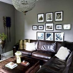 grey walls, brown leather couch