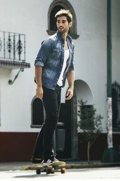 Denim shirt, white T-shirt, jeans and a skateboard