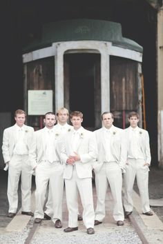 Groom and Groomsmen in White Suits