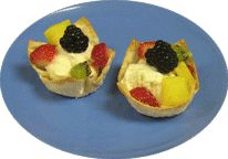 Fruity Smart Tarts – a tasty summer treat made with wonton wrappers, yogurt and fruit.  Young children will have a blast placing the wonton wrappers in a muffin tin and sprinkling them with cinnamon sugar.