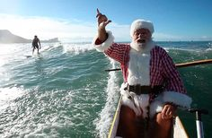 Christmas Traditions: Santa always arrives by boat in Hawaii. Picture shows his 2010 arrival in a outrigger canoe just off Waikiki beach in Honolulu   (Picture of Donald Boyce on December 11, 2010)  #Aqua12staysofchristmas