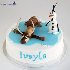 Disney frozen cake - skating and fondant Olaf.