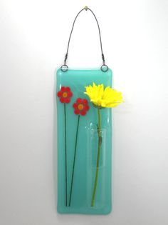 I think this is really sweet, not sure if the glass glue will be strong enough to hold the vase? Give it a go mate