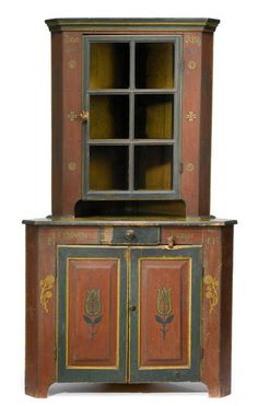 "Sold for $21,250 Rare diminutive painted and decorated stepback corner cupboard    inscribed ""jacob orwig"" and ""elizabeth orwig"" and dated ""1861,"" possibly york county    Molded cornice above single glazed door on base with single drawer and two raised panel doors on bracket base, painted red, green and yellow and decorated with flowerheads, sprigs and tulips.    H: 78 in. W: 32 in. D: approx. 22 in.      PROVENANCE:    Property from the McKnight Collection, Slippery Rock, Pennsylvania."