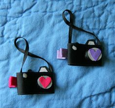 Hey, I found this really awesome Etsy listing at http://www.etsy.com/listing/92265242/camera-shutterbug-ribbon-sculpture-hair