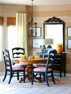 Mirror detail, striped walls, chair fabric
