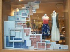 store window display ideas, store windows, store window displays, anthropologie window display, visual merchandising display, shop window displays, anthropologie store display, picture frames, hanging frames