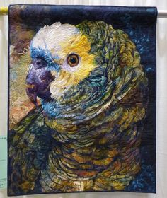 Ruffled Feathers by Roxanne Nelson, parrot quilt.  2012 PIQF. Photo by Lemon Tree Tales.