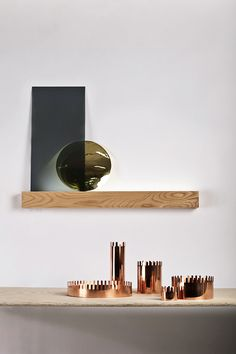 "Compositor - Strek Collective: Light source behind a plank of ash.  I like the idea of a lamp, made up of more than one piece, that creates its own ""setting""; this is a great way to highlight the objects below"