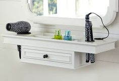 Eight Ways to Organize Your Beauty Products : Lucky Magazine - a hair dressing station you can get up close and personal too.  The only thing missing is a lighted extendable mirror affixed to the wall.