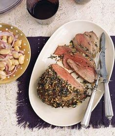 Roasted Tarragon Lamb With Butter Beans recipe: This extremely tender cut of lamb is delicious when roasted whole. Rub the meat with a combination of chopped garlic, dried tarragon, and olive oil before popping it into the oven.