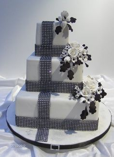 Square black and white classic wedding cake with lots of bling!