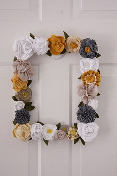 fabric flowers + old frame = a new festive wreath . Pretty!