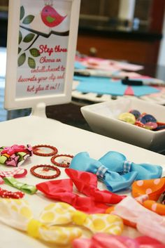 Guests decorate hair bows for baby!