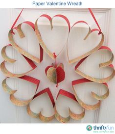 Make a Valentine wreath from scrapbook paper.