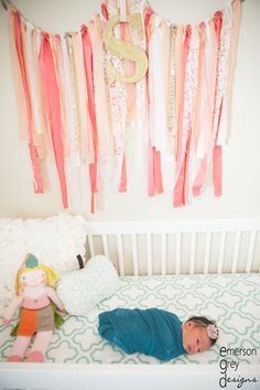 Love the shabby chic touch of this scrap fabric garland in the nursery -xoxo #themommychannel
