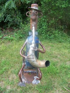 Jazz Man  a motorcycle muffler and two gas cylinders plus other junk was used to make him.  He is for sale.