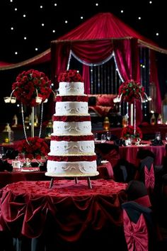 Grand wedding cake with layers of red roses #wedding #weddingcake #cake #red #roses