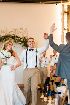 recessional high five :) photo by Brittany Lauren Photography http://ruffledblog.com/leftbank-annex-wedding #weddingideas #ceremony