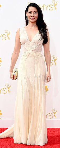 Lucy Liu looked lovely in an ivory gown with draped fabric along the bodice at the 2014 Emmys.