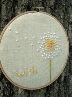 Embroidery Hoop Art Wish in Yellow: I really like the pics I've seen of dandelion seeds flowing off the plant in the wind. This is a great idea! ~AM