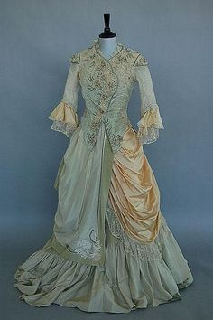 ~A printed cotton 18th century style polonaise gown, circa 1910, comprising of boned bodice with integral sack-back and flounced petticoat~