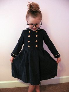 I had a dress almost like this for summer school uniform.  I loved it.  It had a red ribbon instead of the buttons.