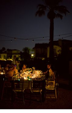 outdoor table under twinkle lights.