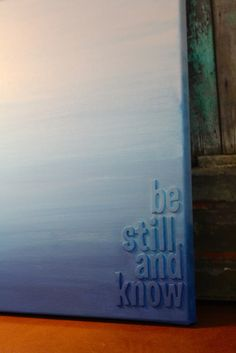 A very simple but very powerful looking piece of art!! Put sticky letters from the craft store on canvas and paint over it.
