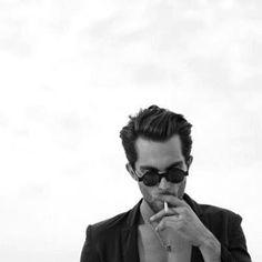 Cool man smoking a cigarette.  model smoking.  http://socialsmoking.com if you smoke.
