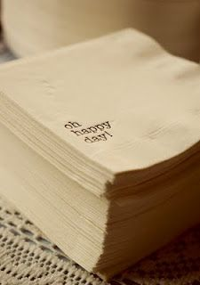 Make your own wedding napkins by using a rubber stamp with food safe ink! Now thats cheap & inexpensive!