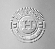 Blind Embossed logo for Henry + Company